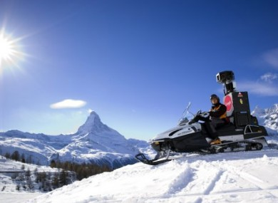 The Google Street View Snow Mobile takes pictures of ski slopes for Google's Street View with the Matterhorn in the background.