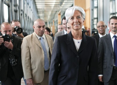 French Finance Minister Christine Lagarde arrives to announce her candidacy surrounded by members of her staff