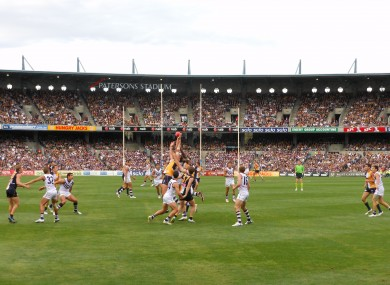 Dean Cox and Nic Natanui of the West Coast Eagles battle for possession in the 33rd Western Derby.