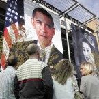Giant banner images of Barack Obama and Elizabeth II are hung out at the Point village in Dublin in anticipation of their visits. (Image: Mark Stedman/Photocall Ireland)