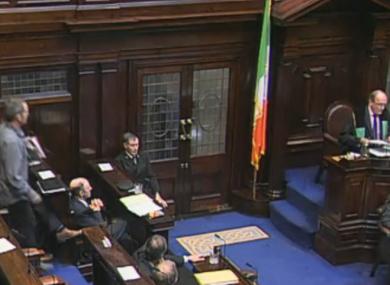 Richard Boyd-Barrett (left) leaves the Dáil chamber after being ordered to do so by Ceann Comhairle Seán Barrett.