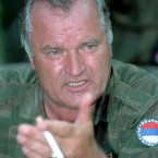 July 1995: The former Bosnian Serb wartime commander Mladic talks with the press near the eastern Bosnian enclave of Zepa. <span class=