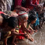 Women splash water on themselves in Thankot as part of Mother's Day in Kathmandu, taking a holy bath to gain some salvation. (Pic: Nabin Baral/Demotix)