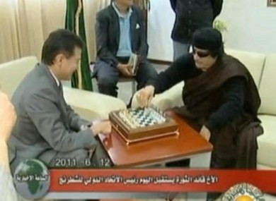 Gaddafi and Ilyumzhinov get down to some serious gaming on Sunday.