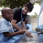 Five-year-old Matt Andy Beauchamps teaches McIlroy how to wash his hands
