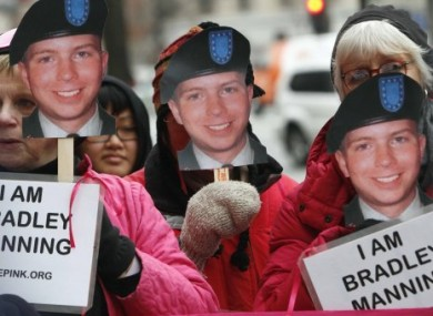 Bradley Manning supporters bearing placards during a demonstration outside the FBI headquarters in Washington DC in January 2011.