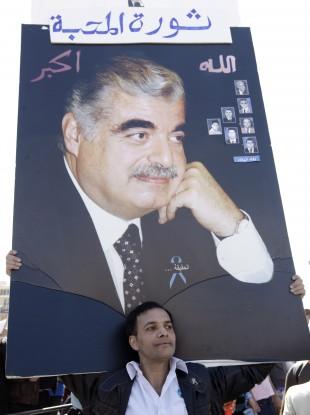 A supporter holds aloft a protrait of Hariri