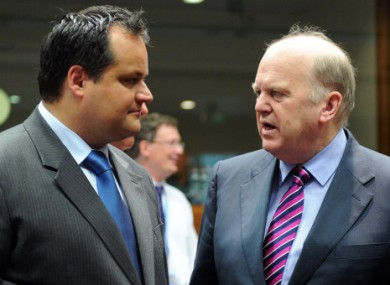 Michael Noonan speaking to the Dutch finance minister Jan Kees de Jager in Brussels last month.