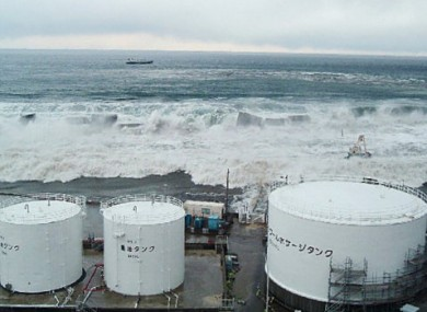 Handout photo from TEPCO showing the tsunami approaching the fuel oil takes of Reactor 5 at the Fukushima plant.
