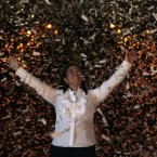 Under pouring confetti, Peru's presidential candidate Keiko Fujimori, of the political party Fuerza 2011, waves to supporters during her closing campaign rally in Lima, Peru, on 2 June, 2011. (AP Photo/Esteban Felix)