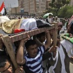 Relatives and friends of tribesmen loyal to Sheik Sadeq al-Ahmar, the head of the powerful Hashid tribe, who were killed in clashes with Yemeni security forces carry their bodies during their funeral procession in Sanaa, Yemen, 3 June, 2011. (AP Photo/Hani Mohammed)