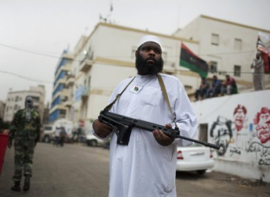A rebel fighter stands guard during Friday prayers in Benghazi, Libya, on 3 June, 2011.