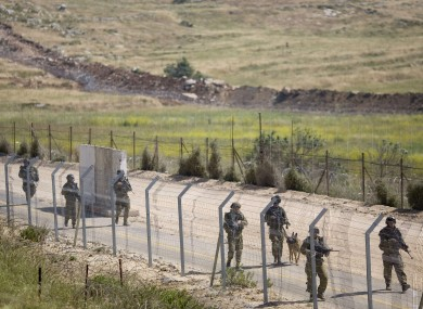 Israeli troops along the Syrian border today.