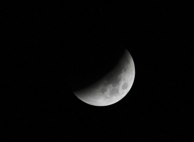 The Earth casts its shadow over the moon in a Total Lunar Eclipse as seen in Manila, Philippines this evening
