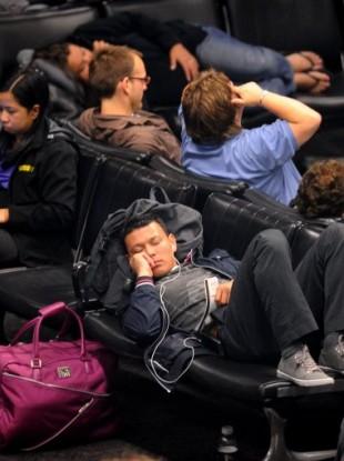 United Airlines passengers waiting at San Francisco International Airport this morning.