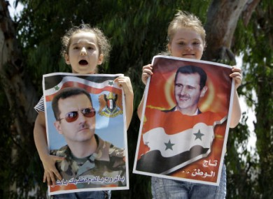 Syrian girls hold posters of President Assad as a show of support in Beirut.