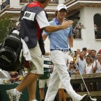 A high five from his caddie JP Fitzgerald.
