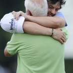 Rory hugs his father Gerry on the 18th green.