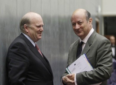 Michael Noonan speaks with his Polish counterpart Jacek Rostowski in Luxembourg today. The summit of EU finance ministers agreed to remove a 'preferred creditor' clause from the EU's new bailout mechanism.