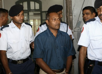 Sandip Moneea, one of the two suspects in the murder of Michaela McAreavey, is escorted to court earlier this week.