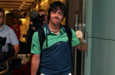 In the swing: this is the first of many for Rory