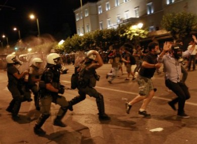 Greek riot police tackling protesters in Athens early this morning.