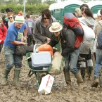 A pack of beer falls off a wheelbarrow at the Glastonbury Festival in Somerset. PRESS ASSOCIATION Photo. Picture date: Thursday 23 June, 2011. Photo credit should read: Yui Mok/PA Wire