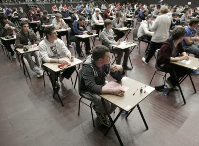 Students at Belvedere College in Dublin sit the second day of their Leaving Cert exams yesterday.
