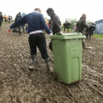 Enterprising festival-goers use a wheelie bin to carry their belongings. Pic: Yui Mok/PA Wire