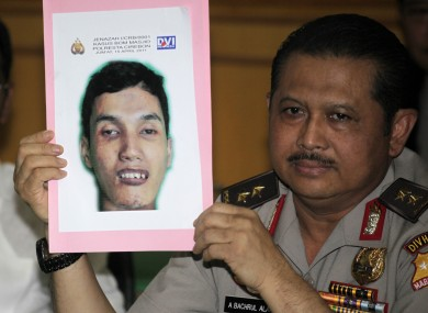 Indonesian National Police spokesperson Maj.Gen. Anton Bachrul Alam holds up a picture of Muhammad Syarif, who blew himself at a mosque inside a police compound on April 15