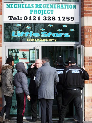 Police officers entering Little Stars Nursery in Birmingham in January