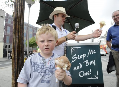 A boy eats an ice cream at the protests against Ireland's austerity programme in Dublin today.
