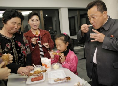 A North Korean family eats at a fast food restaurant in Pyongyang. North Korea's food shortage has become so intense that many have been forced to eat grass.