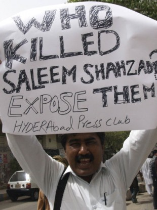June 2011: A Pakistani journalist joins protests against Shahzad's killing.