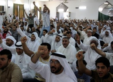 File photo of Bahraini Shiite Muslims calling for the release of political prisoners on 10 June 2011
