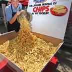 James Gibbs smiles after breaking the current record of 368.5kg for the biggest portion of chips ever served, at Southend-on-Sea, Essex (Chris Radburn/PA Wire)