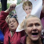 Supporters of Ukraine's former leader Yulia Tymoshenko at a rally in Kiev as she went on trial for abuse of office (AP Photo/Sergei Chuzavkov)