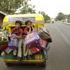 Children on the way home from school in a three wheeled motor rickshaw in Ahmadabad, India (AP Photo/Ajit Solanki)