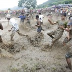 Nepalese farmers splash muddy waters at each other as they celebrate a rice-planting festival (AP Photo/Laxmi Prasad Ngakhusi)