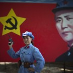 A Chinese tourist dressed as a Red Army soldier poses for photos as China marks the 90th anniversary of the Communist Party (AP Photo/Alexander F. Yuan)
