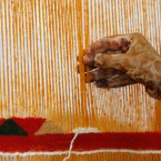 Khadija Ighilnassaf of Morocco weaves a carpet during the opening of the Smithsonian's Folklife Festival 2011 in Washington DC (AP Photo/Jose Luis Magana)