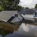 Floodwaters from the Souris River surround homes in Minot, North Dakota (AP Photo/Charles Rex Arbogast)