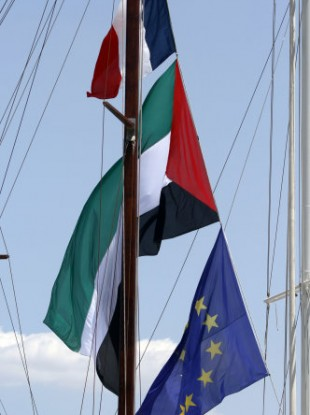 French and Palestinian flags flying on a ship moored in Piraeus yesterday.