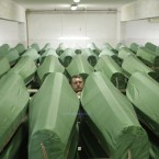 Bosnian worker Edib Vraco sorts name tags on 613 coffins of victims of the 1995 Srebrenica massacre victims, which will soon finally buried. (AP Photo/Amel Emric)