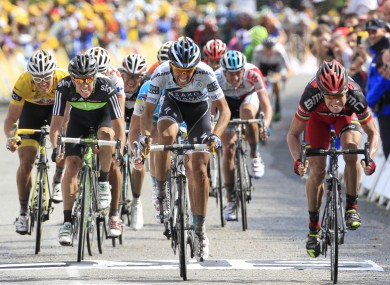 Stage winner Cadel Evans of Australia, right. leads the sprint ahead of three-time Tour de France winner Alberto Contador of Spain, center, and Thor Hushovd of Norway, far left.