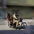 A man and five children ride a motorcycle in Rawalpindi, Pakistan (AP Photo/Muhammed Muheisen)