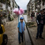 Jose Antonio Gonzalez, 10, waits for customers to to sell candy floss at La Verbena cemetery in Guatemala City (AP Photo/Rodrigo Abd)