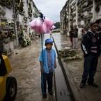 Jose Antonio Gonzalez, 10, waits for customers to to sell candy floss at La Verbena cemetery in Guatemala City (AP Photo/Rodrigo Abd)