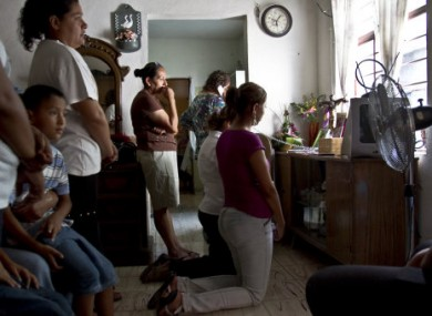 Humberto Leal's relative pray at home in Guadalupe, Mexico, on 7 July 2011.