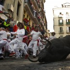 An animal falls during the second running of the bulls in Pamplona, northern Spain (AP Photo/Alvaro Barrientos)